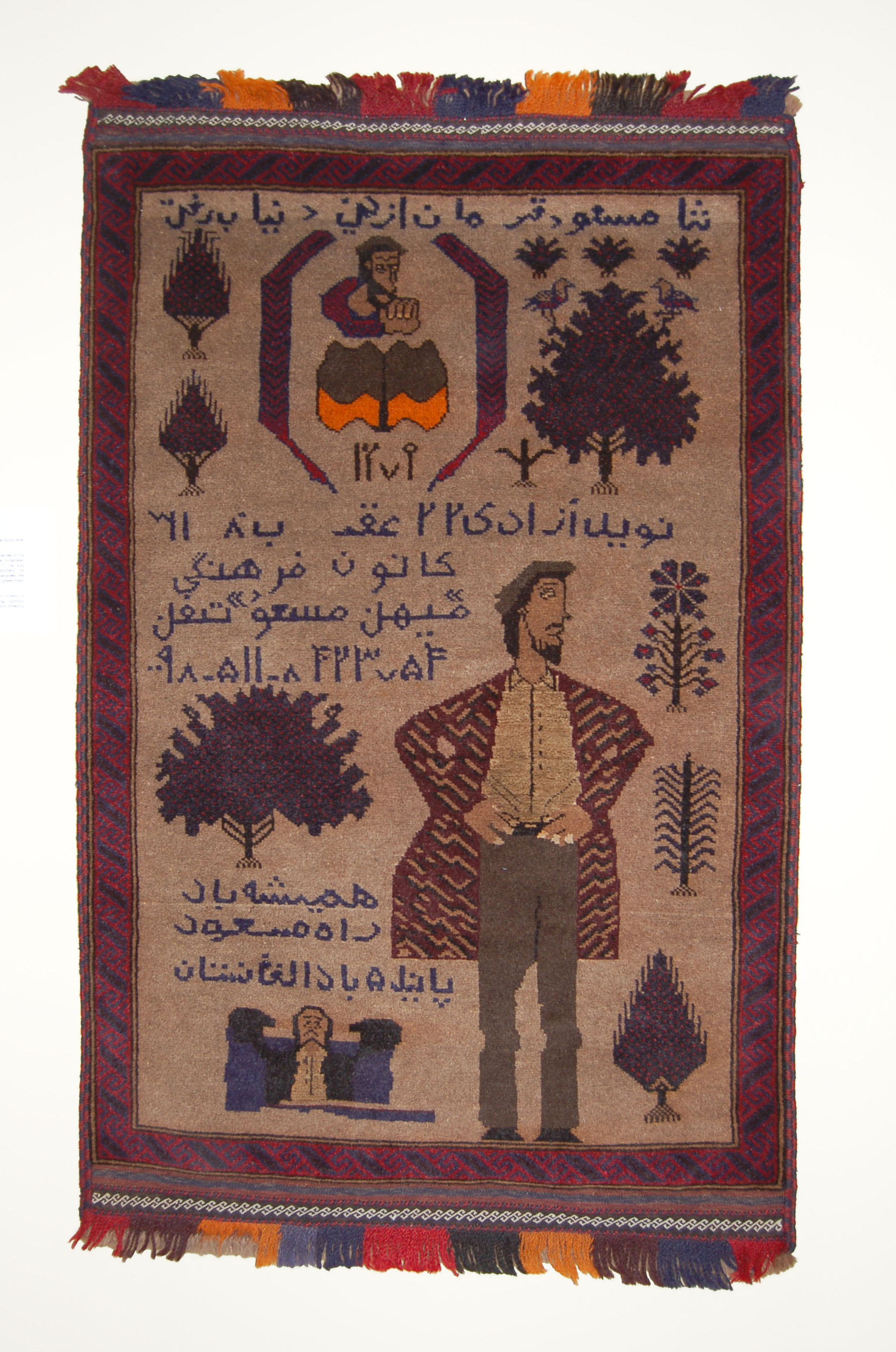 Ahmad Shah Massoud, circa 2002 Baluch; Afghanistan/ Iran Pile woven; wool. NG.2009.070.000. Gift of Robert Fyke, Collection of Nickle Galleries, University of Calgary.